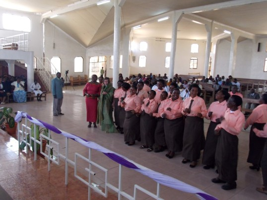 Dancing with the choir after the service in my new cloth.